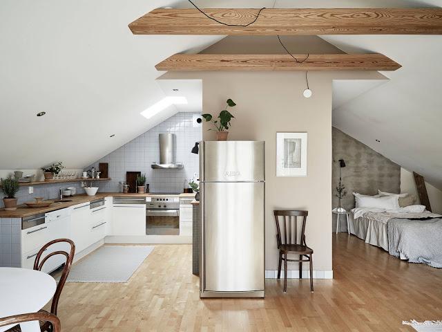 Soluție de amenajare pentru o garsonieră de 47 m² la mansardă