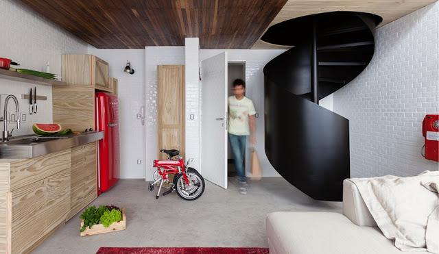 Amenajare modernă, plină de personalitate și cutii de lemn într-un loft de 36 m²