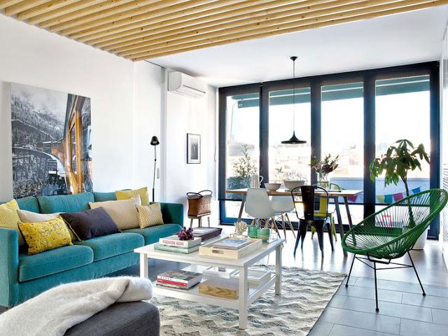 Albastru, verde și galben în amenajarea unui apartament de 70 m² din Spania