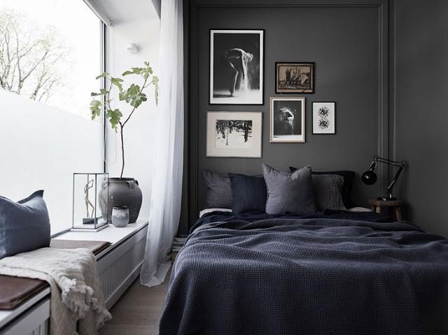 Dormitor amenajat în negru într-un apartament de numai 32 m²