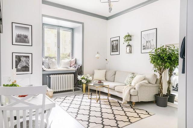 Tonuri neutre de culoare și dormitor lângă bucătărie într-un apartament de 31 m²