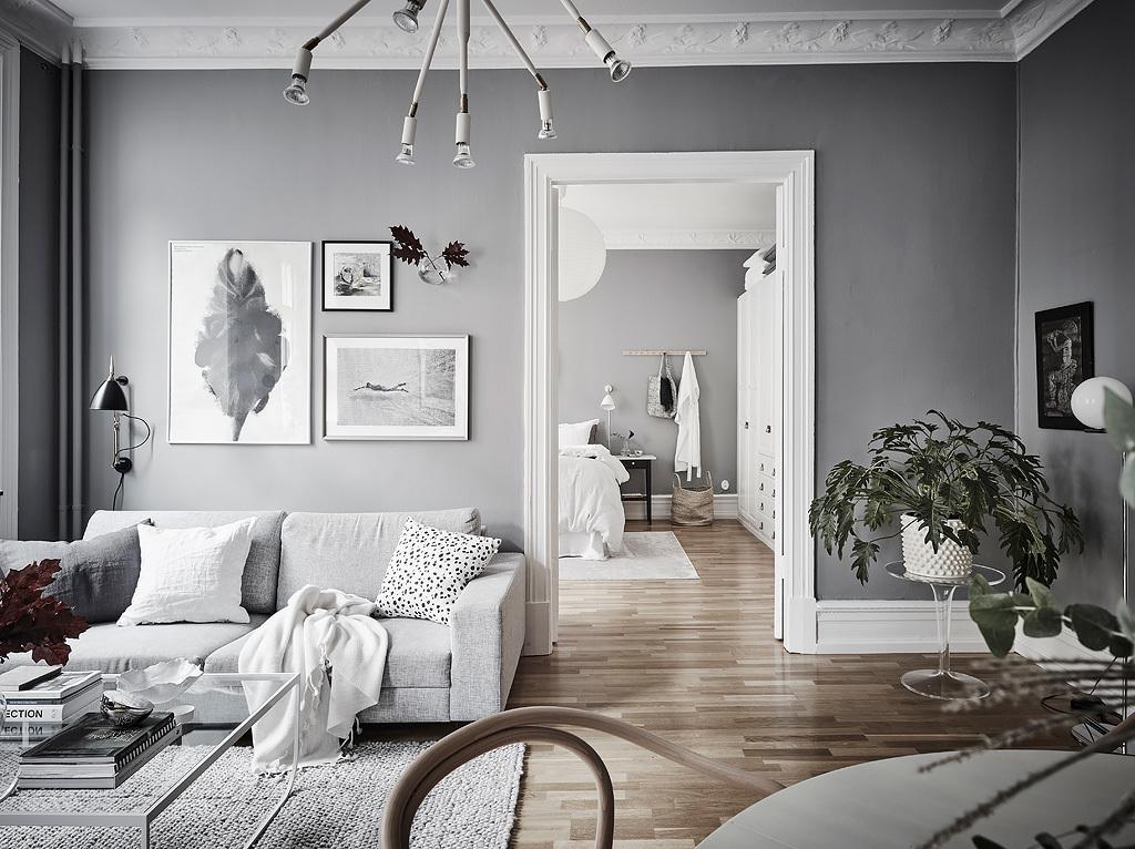 O combinație liniștitoare de gri și alb în amenajarea unui apartament de 63 m²