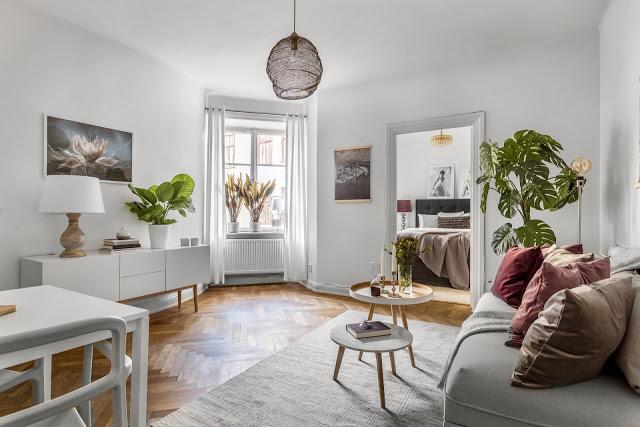 Bucătărie pe colț și o amenajare practică pentru un apartament de 38 m²