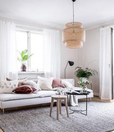 Tonuri neutre de culoare și o amenajare relaxată pentru un apartament scandinav de 59 m²