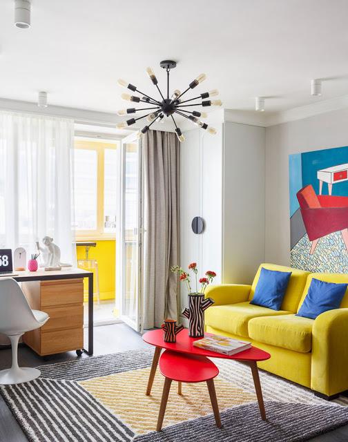 Culori tari și o amenajare practică pentru o garsonieră de 34 m²