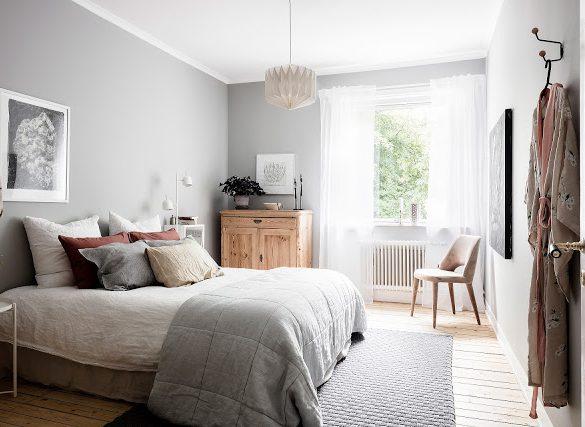 Plan deschis cu accente de gri și crem în amenajarea unui apartament de 49 m²