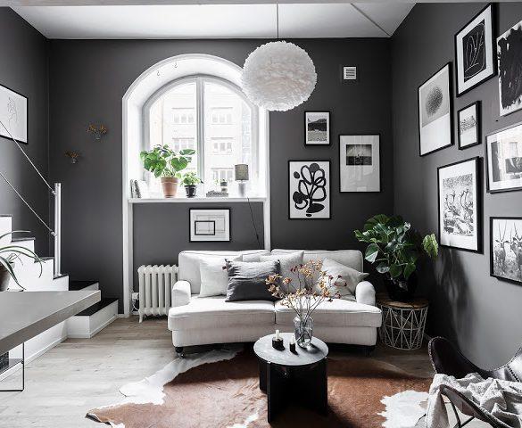 Pereți negri și dormitor la mezanin într-o garsonieră de 34 m²