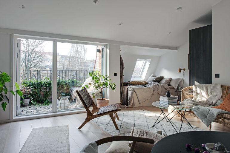 Design interior practic și scandinav într-o mansardă în plan deschis [36 m²] 10