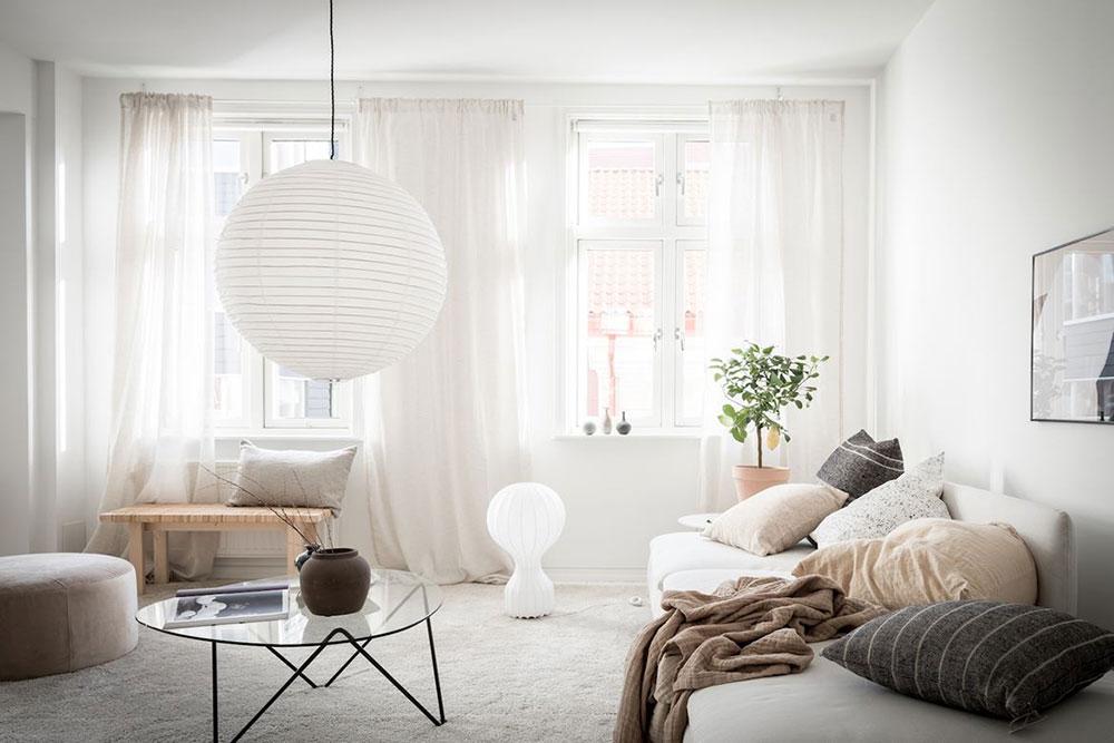 Minimalism scandinav, lemn și textile naturale într-un apartament din Suedia 1