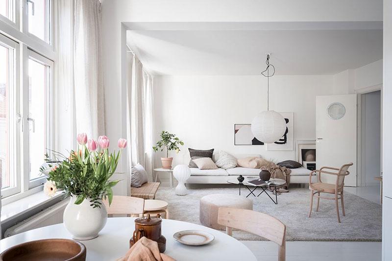 Minimalism scandinav, lemn și textile naturale într-un apartament din Suedia 2
