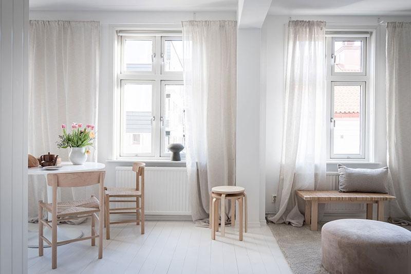 Minimalism scandinav, lemn și textile naturale într-un apartament din Suedia 9