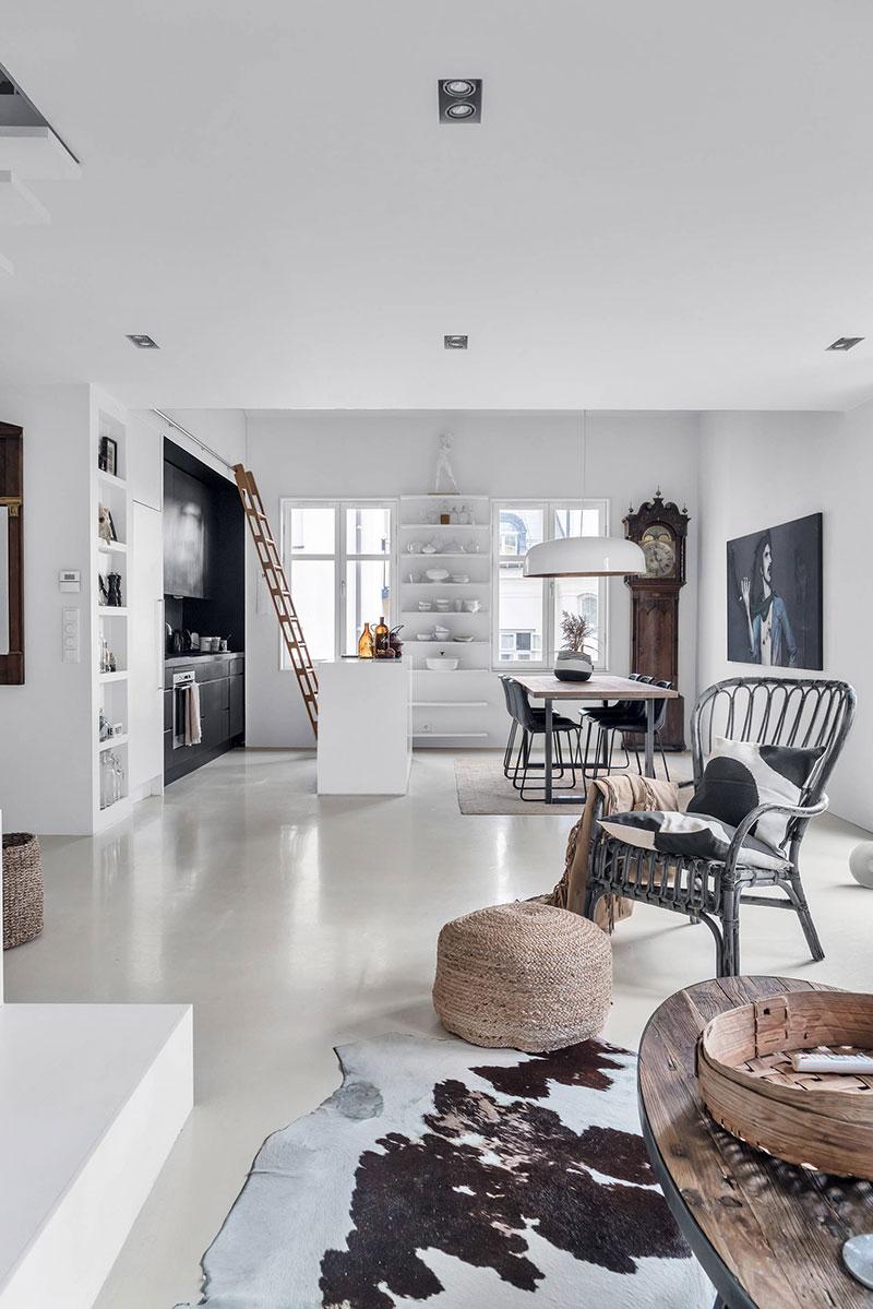 Scări din lemn, ramuri de copaci și accente vintage într-un apartament pe două niveluri 8