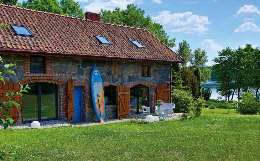 Decor rustic boem și colorat într o casă din Ełk Polonia 15