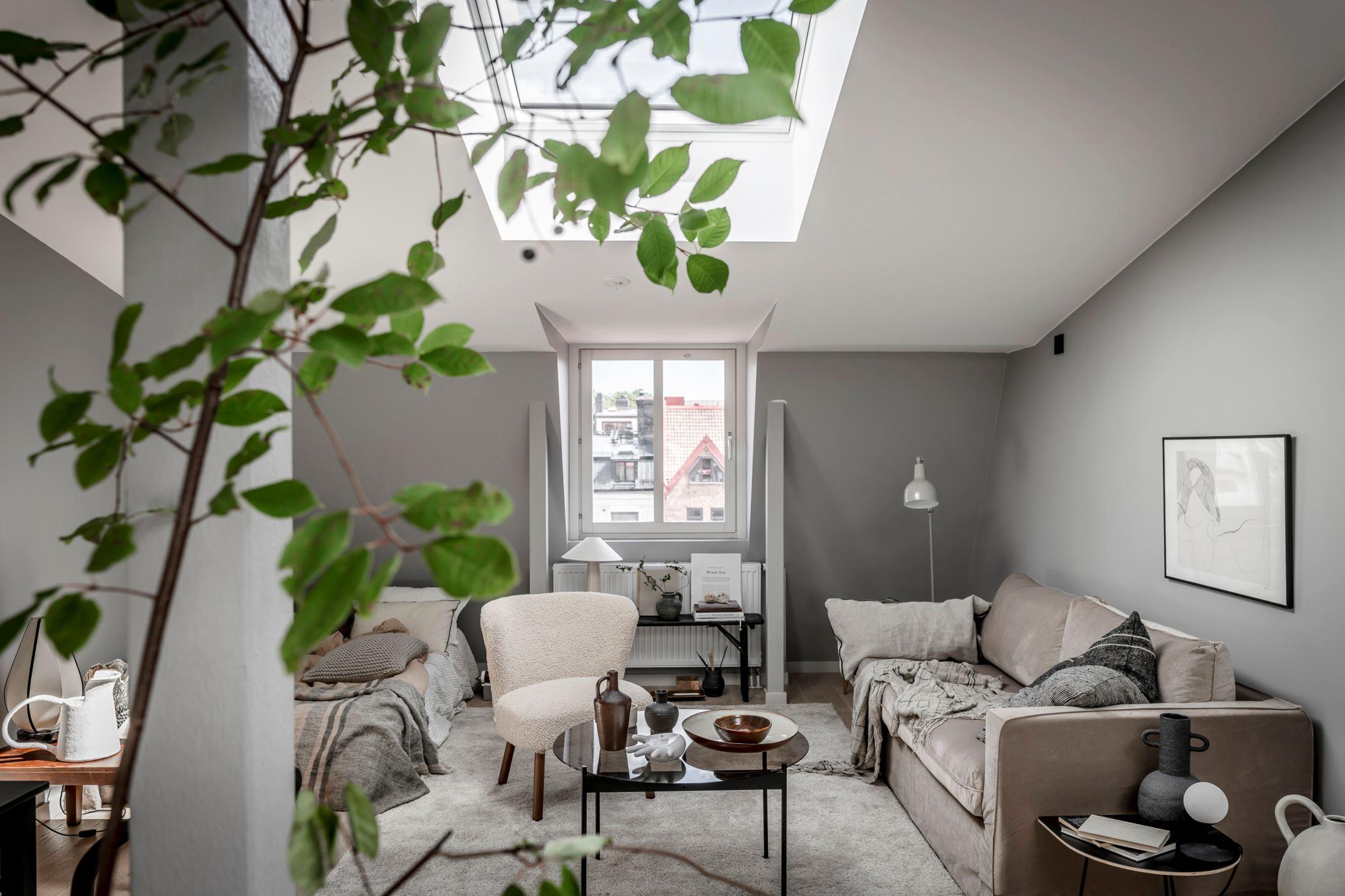 Plan deschis și decor nordic într o garsonieră la mansardă 35 m² 12