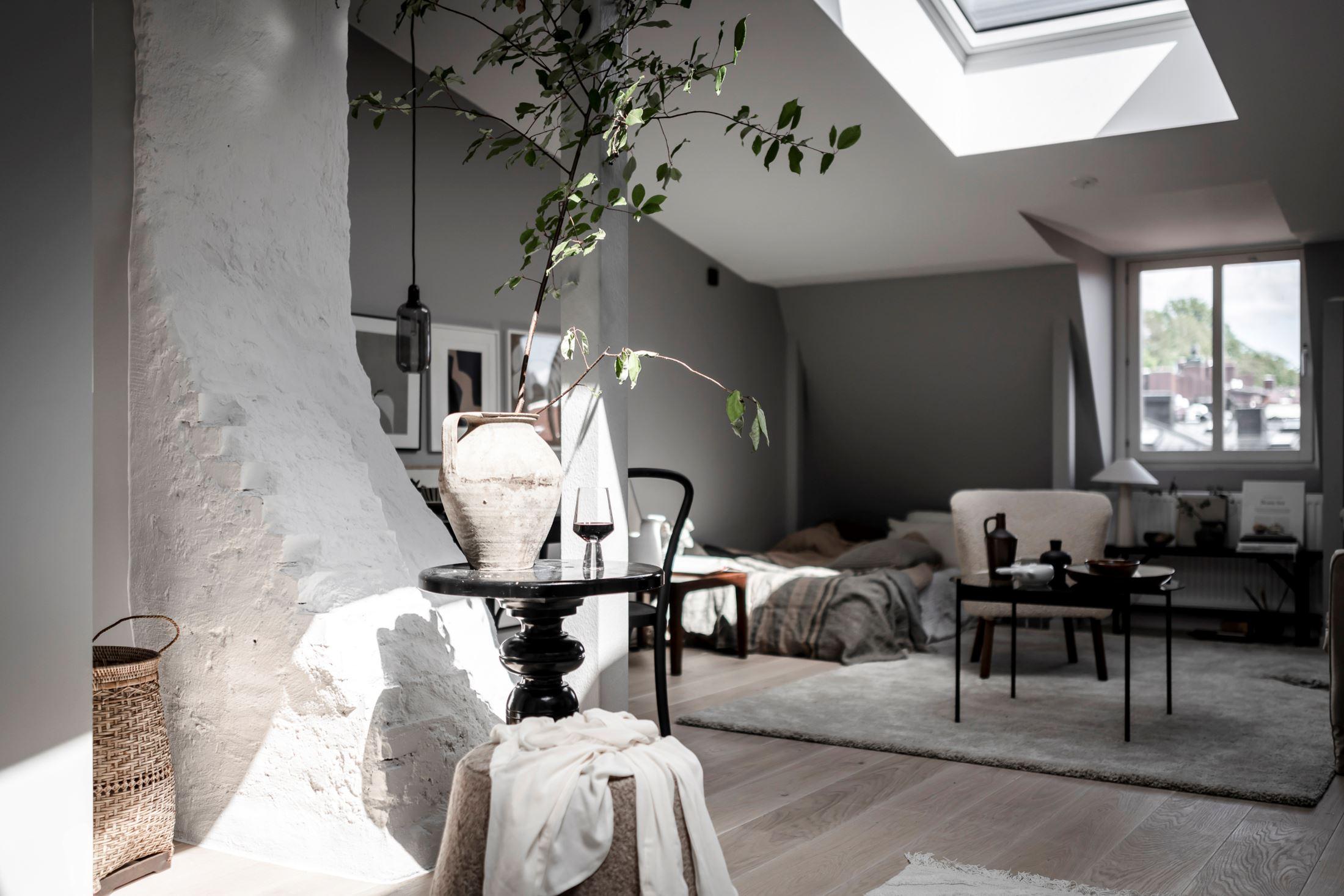 Plan deschis și decor nordic într o garsonieră la mansardă 35 m² 14