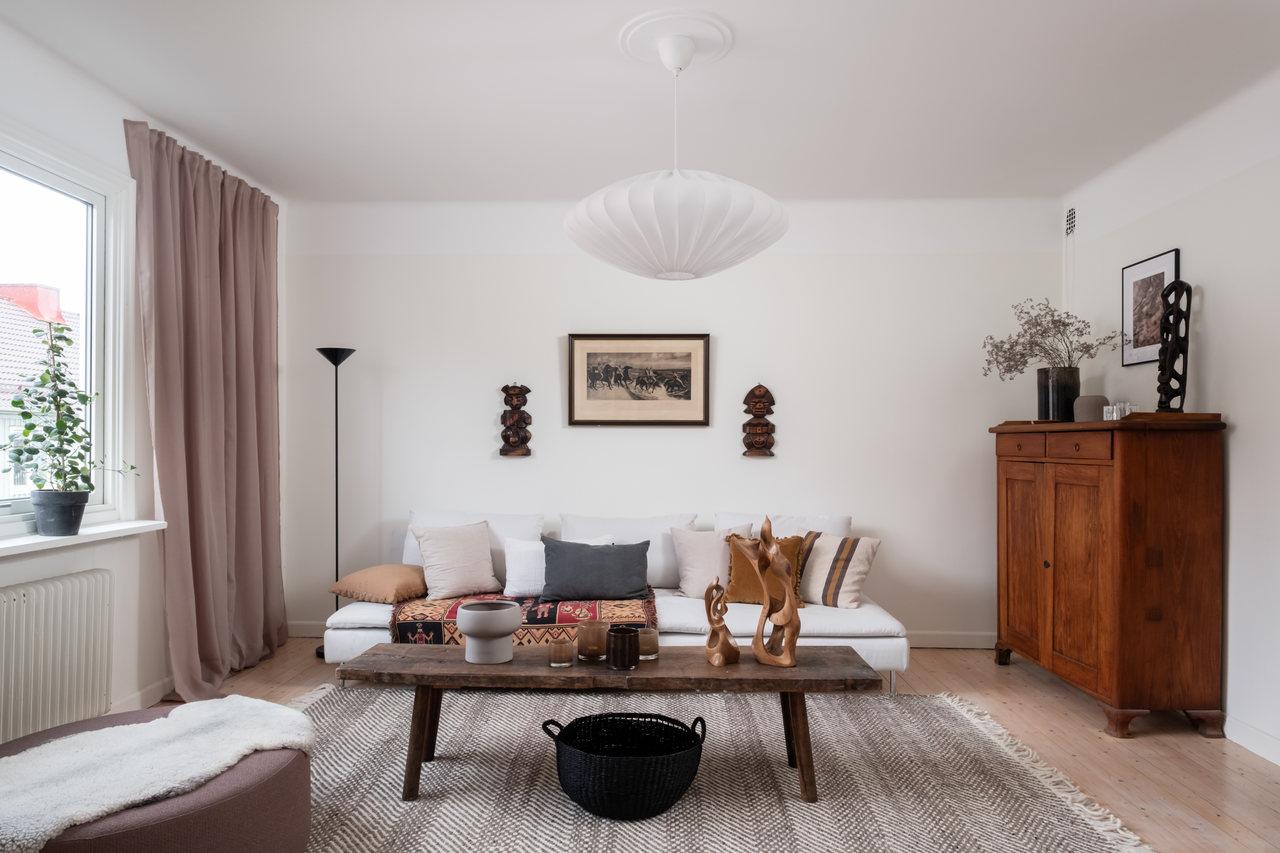 Motive etnice și accente calde de culoare într un apartament de 76 m² 1
