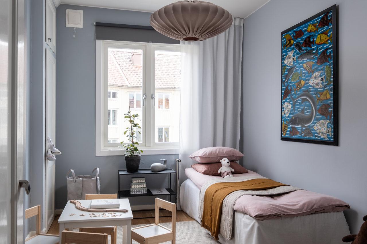 Motive etnice și accente calde de culoare într un apartament de 76 m² 10