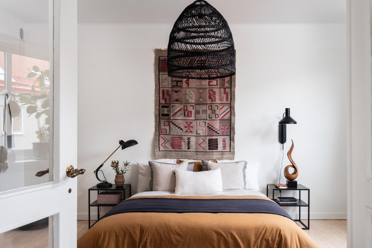 Motive etnice și accente calde de culoare într un apartament de 76 m² 5